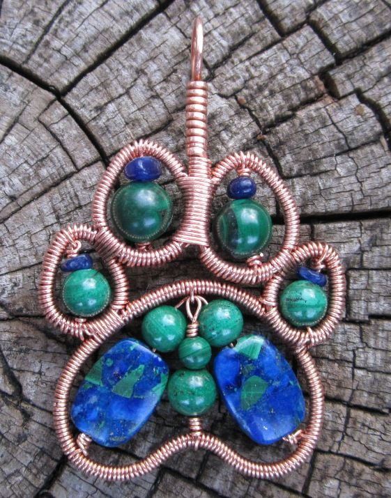 Beautiful paw print pendant by Scott Ihrig http://www.jewelrywirewrap.com                                                                                                                                                      More