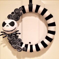 JACK SKELLINGTON WREATH Everybody scream in our town of Halloween! This 14 wreath is wrapped with black and white yarn, and embellished with