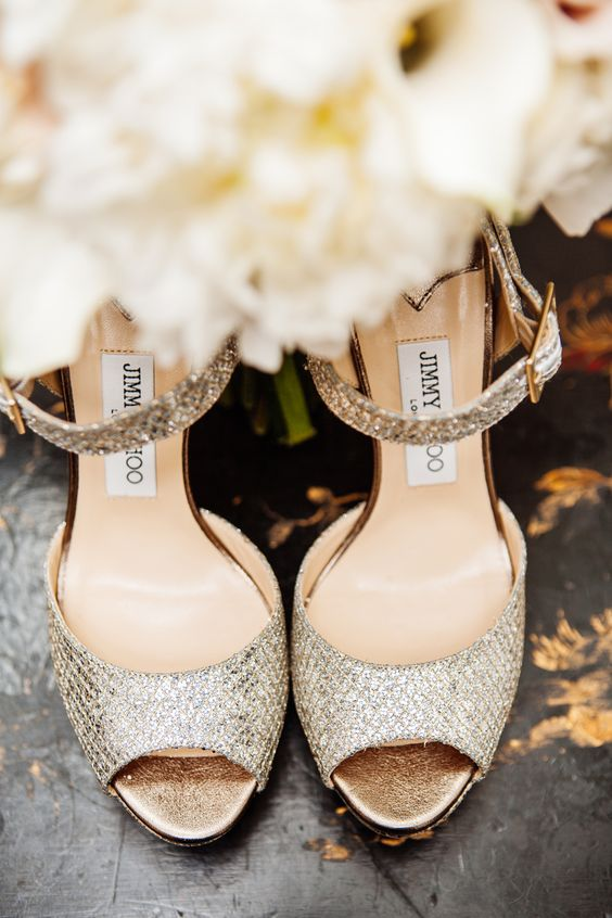 Champagne glitter Jimmy Choo bridal shoes. Capturing all the details of your wedding day is our specialty. #artisticimagery