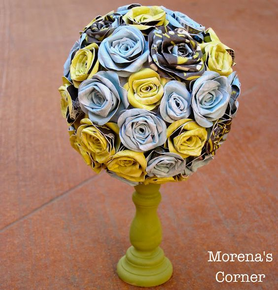 Handmade paper flower topiary.  Use a candlestick and paper flowers to make a beautiful centerpiece!  Updated with new pictures.  Tutorial.