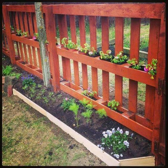 LOVE the little planter boxes on the fence.
