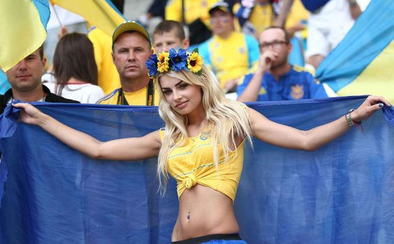 Editorial use only. No merchandising. For Football images FA and Premier League restrictions apply inc. no internet/mobile usage without FAPL license - for details contact Football Dataco Mandatory Credit: Photo by Michael Zemanek/BPI/REX/Shutterstock (5735508bq) Fan of Ukraine with flag   during the UEFA Euro 2016 Group C match between  Ukraine and Poland   played at Stadium Velodrome , Marseille , France on June 21st 2016 Football - UEFA European Championships 2016 Group Stage Group C…