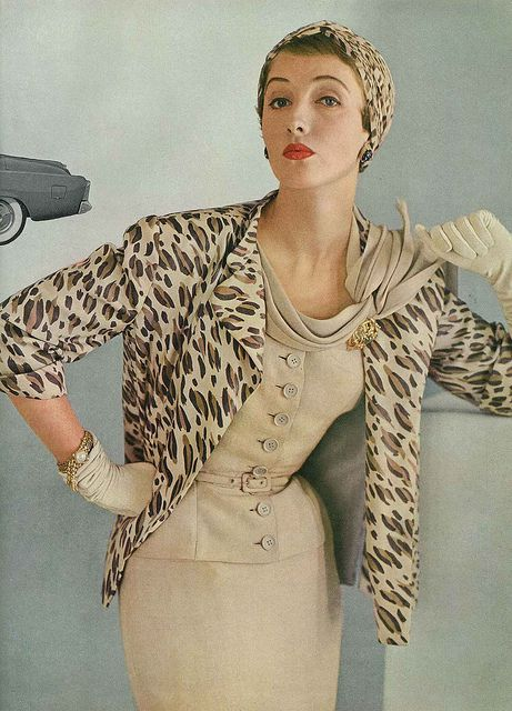 February Vogue 1953. Model is wearing a beige silk suit by Adele Simpson, available at B. Altman & Co.