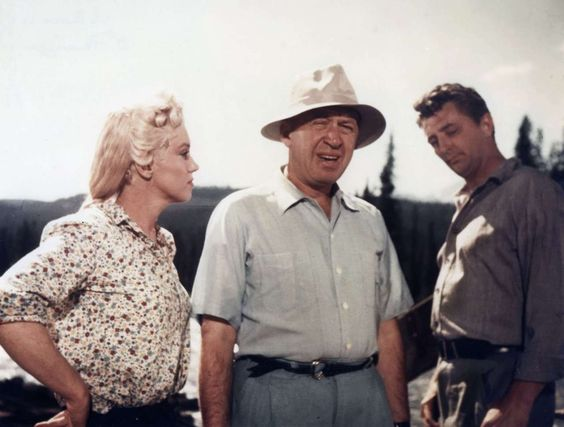 """Marilyn Monroe and Robert Mitchum on the set of """"River Of No Return"""", 1954."""