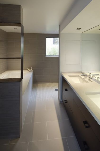 low maintenance bath - slab counter, no glass...walk around shower...large tiles for fewer grout lines