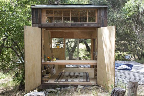 The Topanga cabin is an off grid structure constructed of 80% re-used materials. Sited to maximize southern exposure in a heavily wooded area, the cabin func...