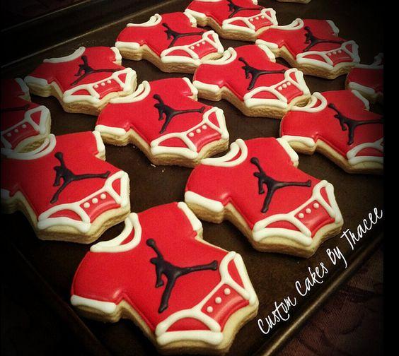 jordan logo baby shower onesie cookies by custom cakes by tracee via