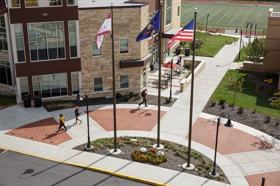 """#Alvernia's motto """"To Learn, To Love, To Serve"""" is as relevant today as it was in 1958 when the school was founded. #aerial #flags"""