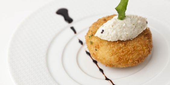 Crab cakes are paired with crab chutney in a spectacular celebration of crab meat by Vineet Bhatia. This flavoursome crab cake recipe makes great use of bold spices