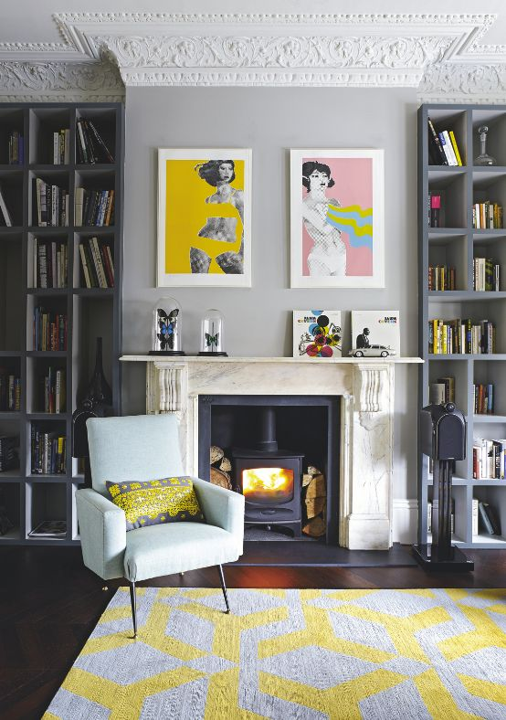 Gerald Laing's pop art prints liven up this lovely living room. Photo: Livingetc: