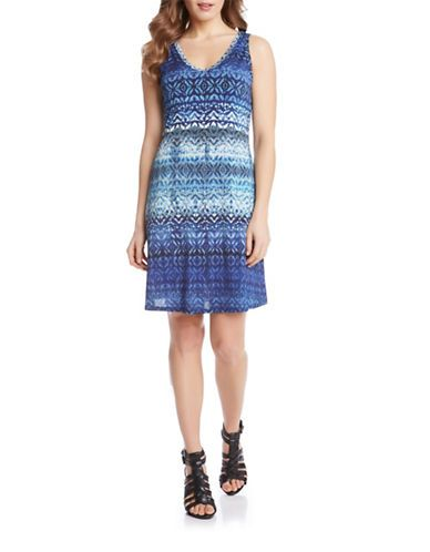"<ul> <li>A head-turning batik print invigorates this V-back design</li> <li>V-neck</li> <li>Sleeveless</li> <li>Pullover style</li> <li>About 36"" from shoulder to hem</li> <li>Polyester</li> <li>Machine wash</li> <li>Made in USA</li></ul>:"
