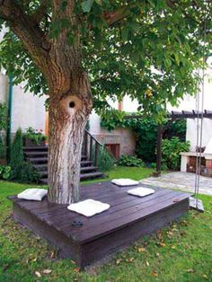 Seating deck around the tree trunk: 26 Awesome Outside Seating Ideas You Can Make with Recycled Items