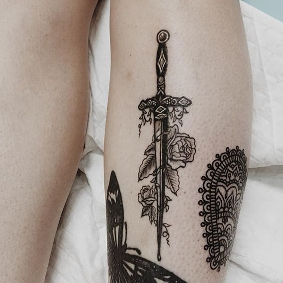 @laurenwinzer on Instagram. Black and white detailed sword tattoo