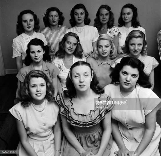Teenage girls with a shoulder length hairstyle posing for the picture in Tulsa OK in 1947