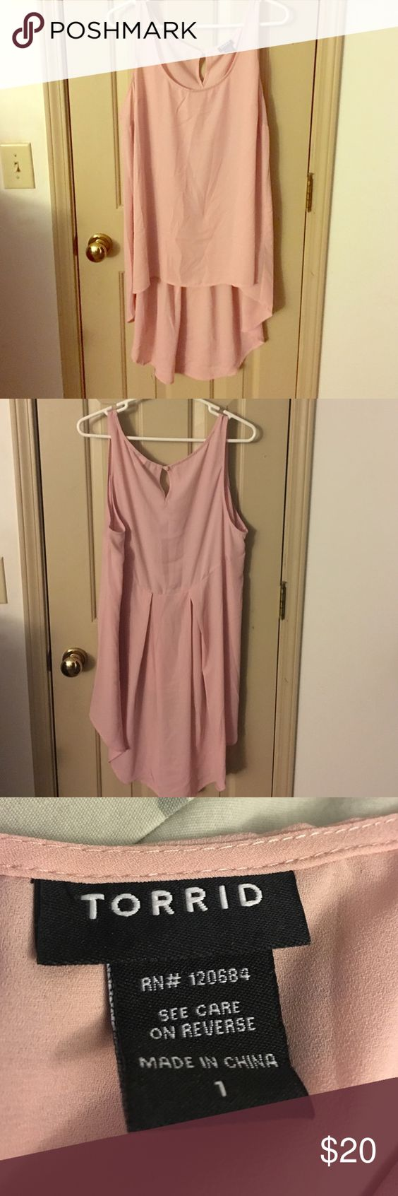 Blush Torrid hi lo tank Cute blush tank from Torrid with hi lo cut. Great with a pair of heels and Jeggings. Worn one time to opening night event. torrid Tops