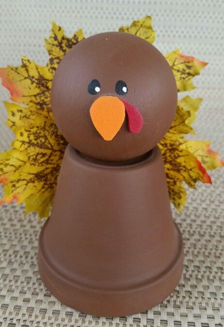 Thanksgiving turkey clay terracotta pot with wooden doll head, leaves, & foam pieces - image only.