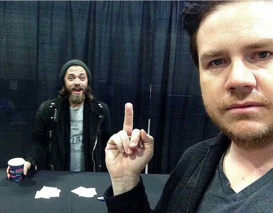 Just another cast member flipping the bird...Norman is a bad influence, LOL