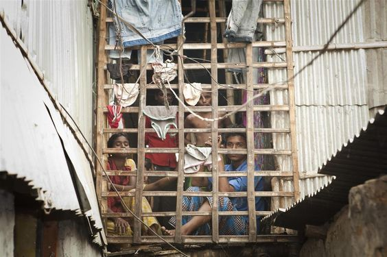 Residents of the Jhilparh slum in Bangladesh