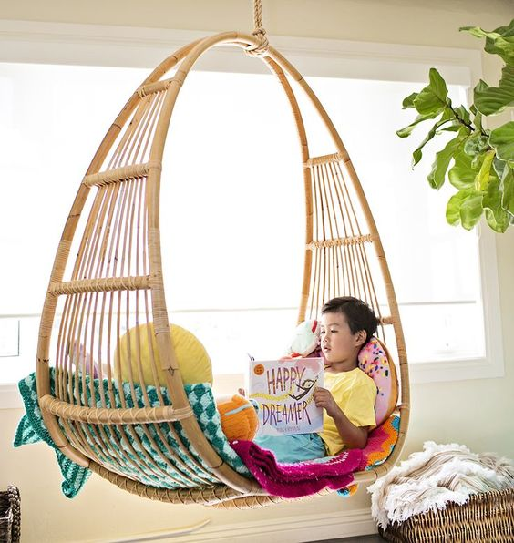 Cozy reading nook for kids hanging chair for kids home. Featuring Happy Dreamer inspirational children's book.