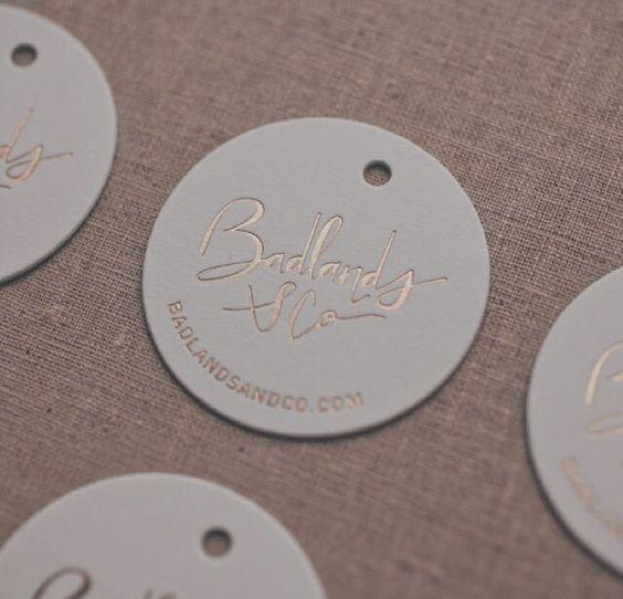 Matt golf foil-pressed swing tags for Badlands Co by Stitch Press