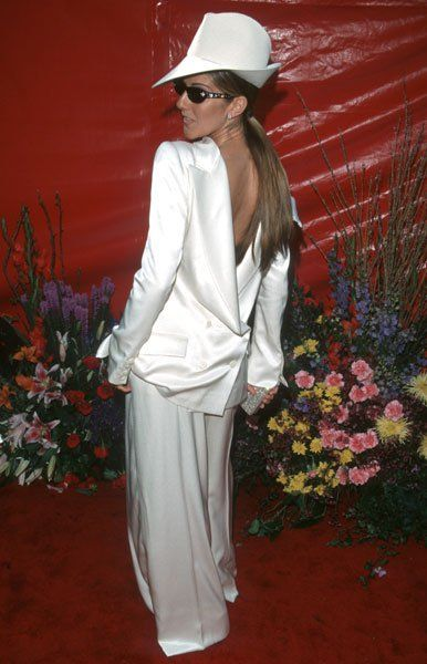 Pin for Later: 81 Unforgettable Looks From the Oscars Red Carpet Celine Dion at the 1999 Academy Awards Celine made a major fashion statement in her backwards Dior suit in 1999.