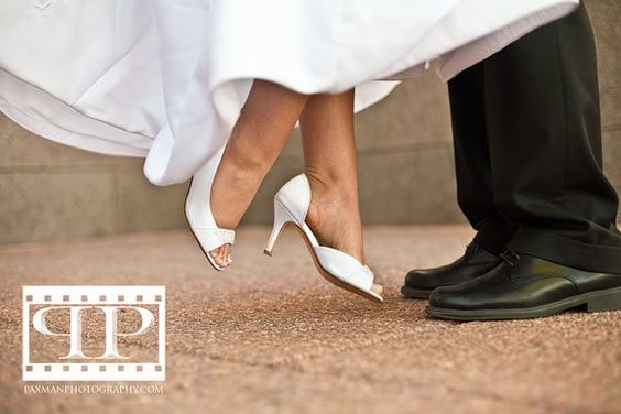 Sweep me off my feet. Wedding photography. Bride. Unique shoe shot.