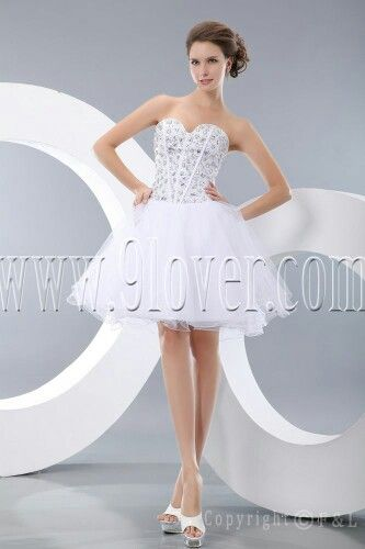 A beautiful short wedding dress with a crystal bodest