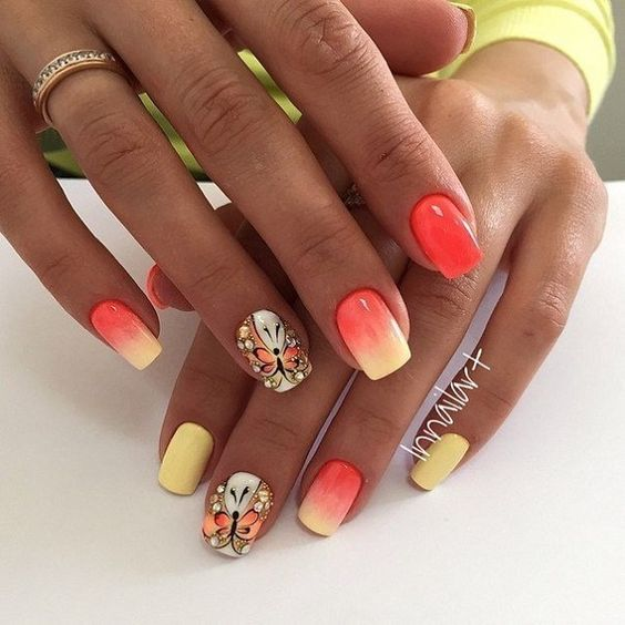 Sun kissed butterfly nail art design. Inspired by the bright colors of the sun, the yellow and melon combination is simply perfect in gradient with the butterfly outline in the same color combination.