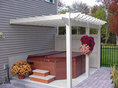 The hot tub gazebo here is attached directly to the side of the building, which is great for anyone who wants their hot tub directly by their house. It's also a standard look with a white wood.