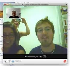 This is an example of someone using an internet chat service to communicate with their friends. It shows multiple people coming together in one group to talk to their unavailable friend, who is able to still maintain communication through the use of video chat. This is the primary purpose of video chat, to make communication more efficient.