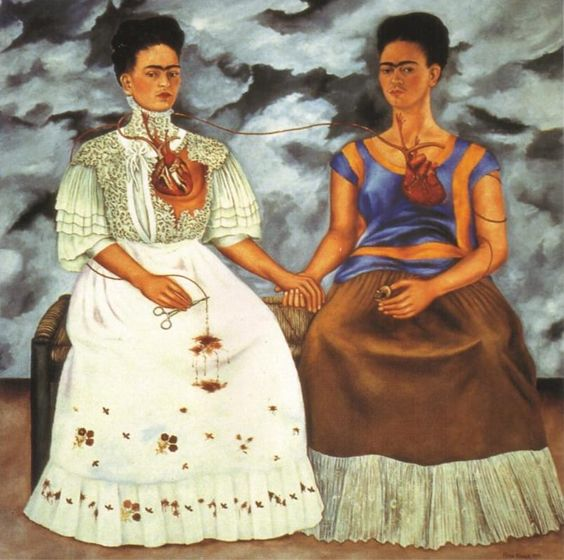 The Two Fridas, 1939 by Frida Kahlo. This painting was completed shortly after her divorce with Diego Rivera. This portrait shows Frida's two different personalities. One is the traditional Frida in Tehuana costume, with a broken heart, sitting next to an independent, modern dressed Frida. it expresses her desperation and loneliness with the separation from Diego.