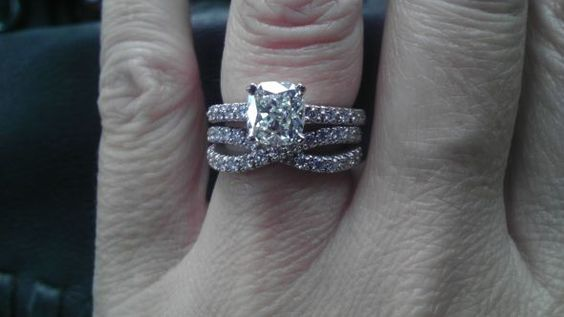 Plain engagement with a twisted wedding band.