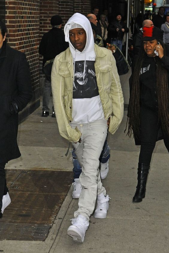 ASAP Rocky wearing Rick Owens Jacket, Pyrex Religion Hoodie, and Nike Air Force 1 Sneakers