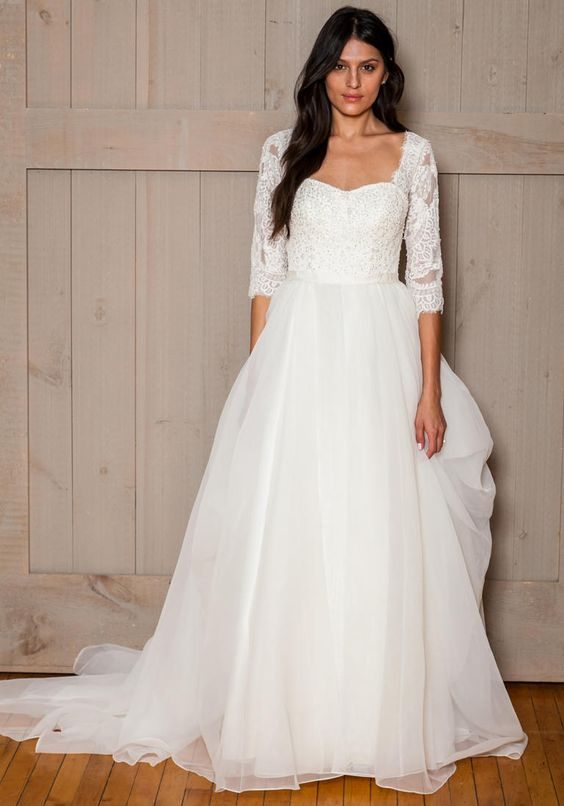 David's Bridal Fall 2016 3/4 lace sleeve wedding dress with tulle skirt | https://www.theknot.com/content/davids-bridal-wedding-dresses-bridal-fashion-week-fall-2016