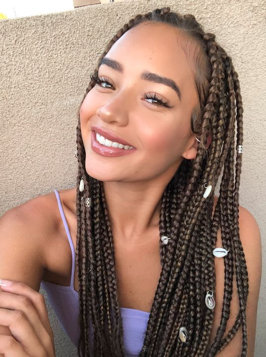 straight braided hairstyle with beads