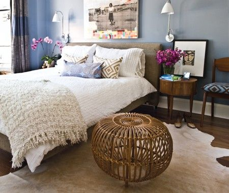 A soothing, cool blue-grey.                Seema Persaud, our web promotions editor, picked a lovely hue that's perfect for a contemporary bedroom: Benjamin Moore's Oxford Gray (2128-40). Try it in a living room with dark wood furniture for a nice balance of warm and cool tones, too.