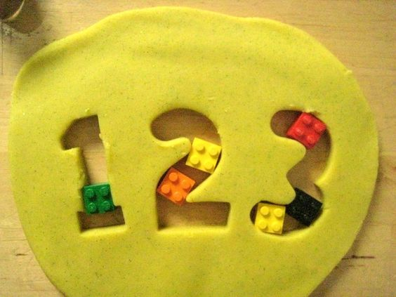 When did you start to help your children learn to count? Play dough + math games = a fun way to start their learning!