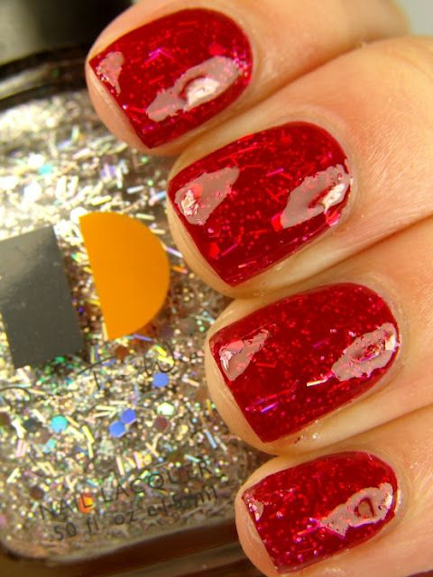 Red nail polish, glitter layer and another layer of red