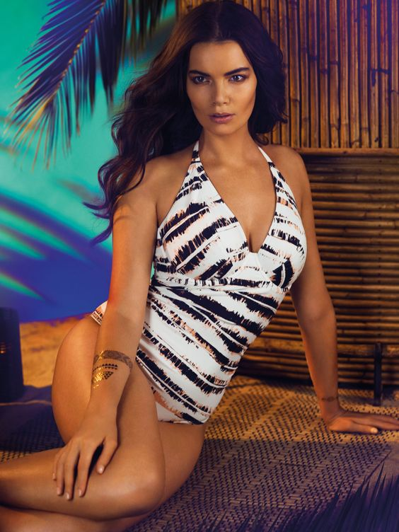Castaway keeps it classy in a must-have monochrome print, complete with touches of soft peach tones. For a sophisticated and statement-making look, opt for the halter swimsuit, featuring padded foam cups and a wide clasp at the back for fantastic shape and support, alongside a low plunging neckline and gathers over the tummy area for a figure flattering feel - available from a C to an FF cup.