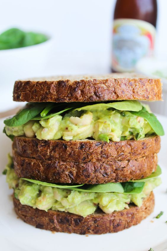 This Smashed White Bean, Basil, & Avocado Sandwich takes about 5 minutes and 5 ingredients for a quick and easy weeknight dinner! {vegan, gluten free}: