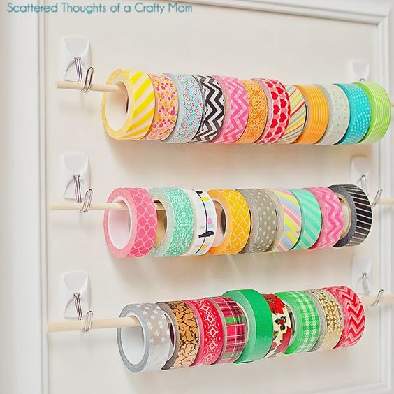 Easy ribbon, duct tape, ect. storage. Use two Commands of your choice and put dowel on them.