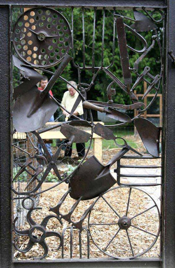 a smith's gate, made by his son when the boy was just beginning to learn the art