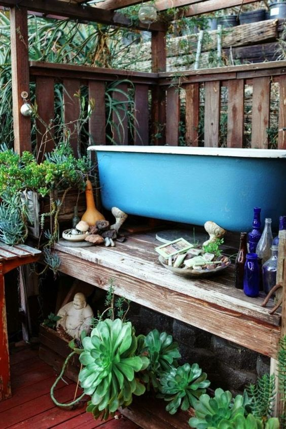Bathroom, Rustic outdoor tropical bathroom blue clawfoot tub wooden floor succulent plant stainless steel faucet small sculpture: Tropical Outdoor Shower And Bathroom