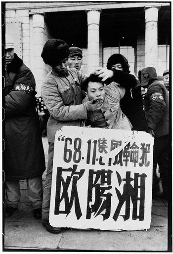 Ouyang Xiang, son of the former first secretary of Heilongjiang's provincial party committee, was dragged outside the North Plaza Hotel, persecuted for sending an unsigned letter to the provincial revolutionary committee defending his denounced father. Three days later, he was pushed out of a third-story window of the building where he was held. The official report called his death a suicide. Harbin, Heilongjiang province, Nov. 30, 1968. Li Zhensheng: