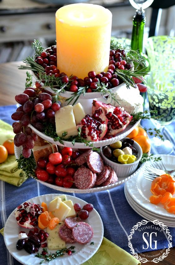 "Vertical Cheese Board:  Cheeses:  one hard cheese (sharp cheddar), one soft cheese (Borsin), one ""stinky"" cheese (French Bleu), two favorites (Havarti and Manchego - Meats: hard salami, pepperoni, sporessata - Fruits: cherries, grapes, clementines, pomegranates:"