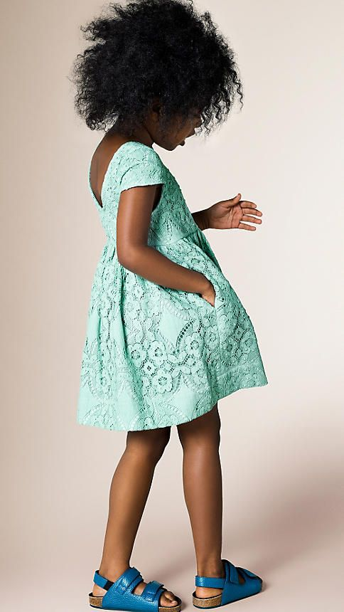 A Burberry waisted dress in English lace with a cap sleeve design. Discover the childrenswear collection at Burberry.com
