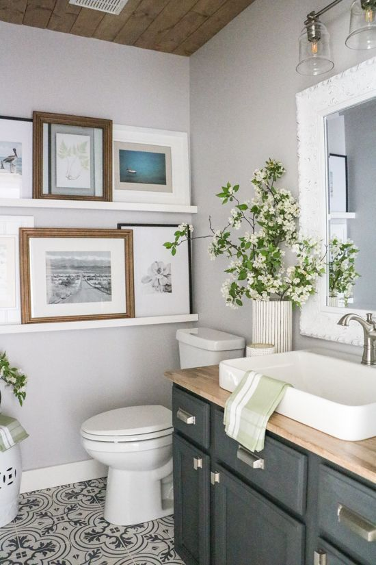 Small Bathroom modern farmhouse - dark vanity with wood ceiling and countertops, and patterned tile floor