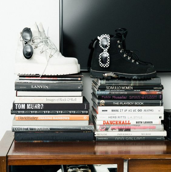Jahleel Weaver's Closet:The Jr. Creative Director of Fenty Corp,has a closet bursting with silk and, of course, Puma. -- Black and White Fenty x Puma sneakers and checkered Vintage Gianni Versace sunglasses. | Coveteur.com