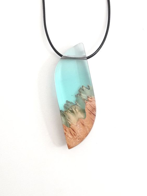 Unique ocean pendant. Pale blue resin and wood pendant necklace. Handmade jewelry by WoodAllGood. #WoodAllGood