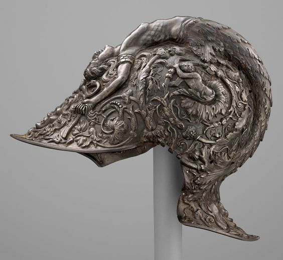 "Filippo Negroli (Italian, ca. 1510–1579). Burgonet, dated 1543. The Metropolitan Museum of Art, New York. Gift of J. Pierpont Morgan, 1917 (17.190.1720) | This masterpiece of Renaissance metalwork is signed on the browplate by Filippo Negroli, whose embossed armor was praised by sixteenth-century writers as ""miraculous"" and deserving ""immortal merit."" #OneMetManyWorlds:"